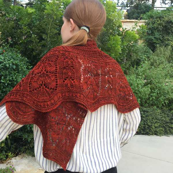 model wearing dark red Feuille-morte shawl wrapped around shoulders, closeup of twisted stitch lace texture