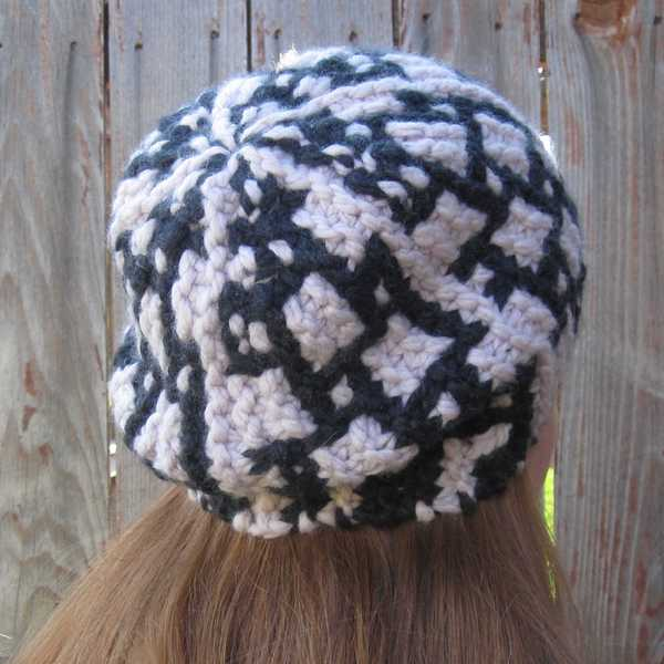 three-quarters angle back view showing the hazier stitch definition of Carreau hat in wool