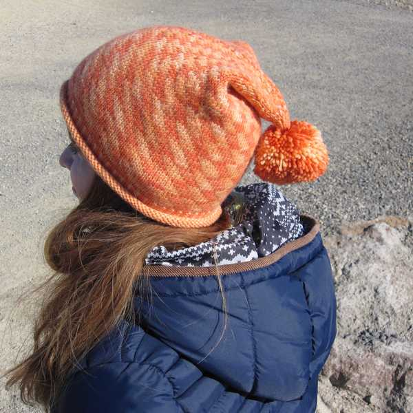 side view of orange Electricity hat detailing the drape and subtle stitch definition